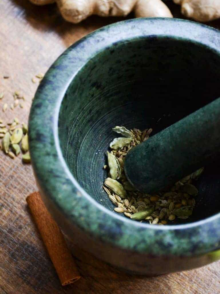 a mortar and pestle grinding spices