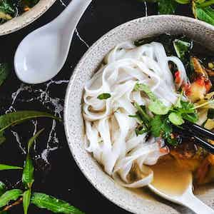 a bowl of soup with rice noodles