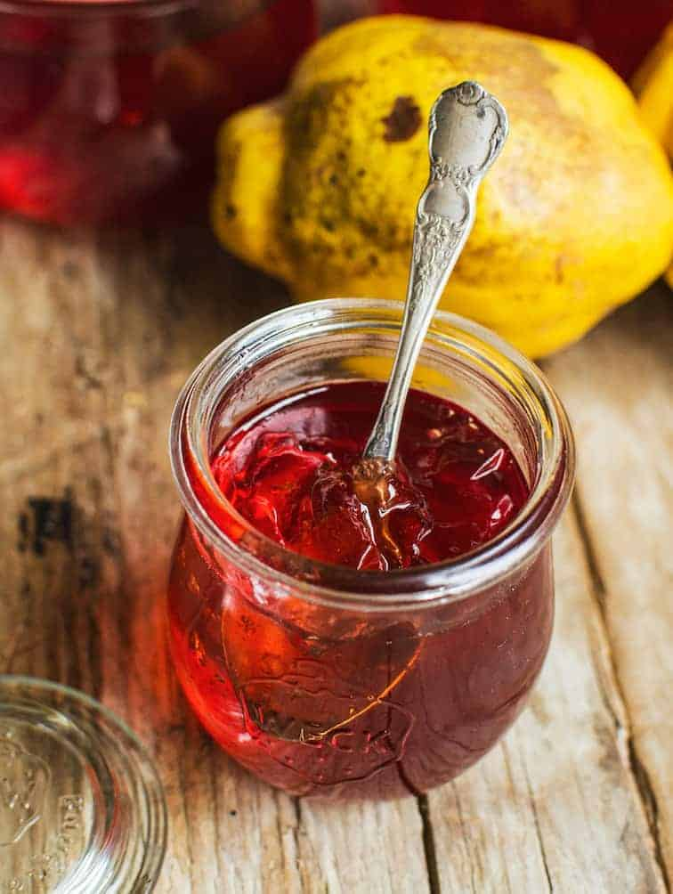 a jar of red quince jelly