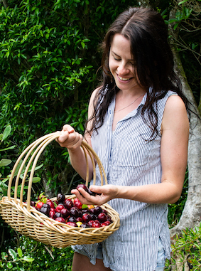 A girl with a basket of plums