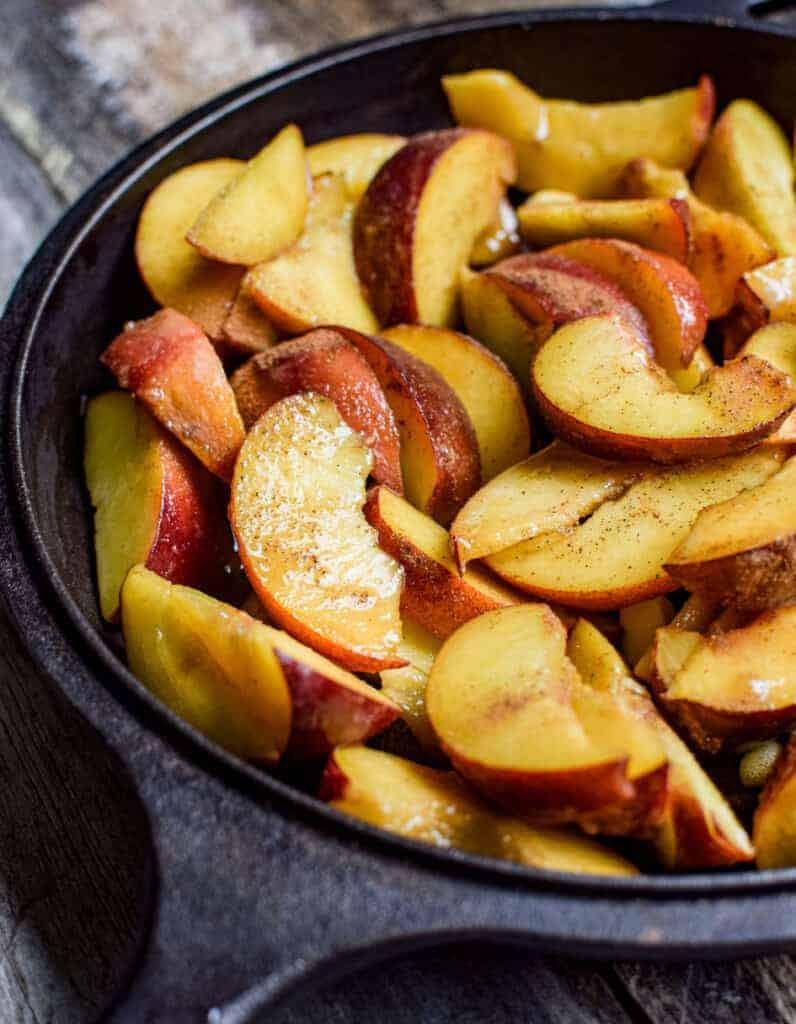 close up of sliced peaches in a skillet