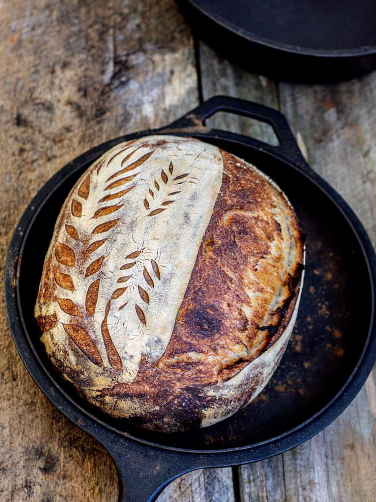 a loaf of bread In a cast iron pan