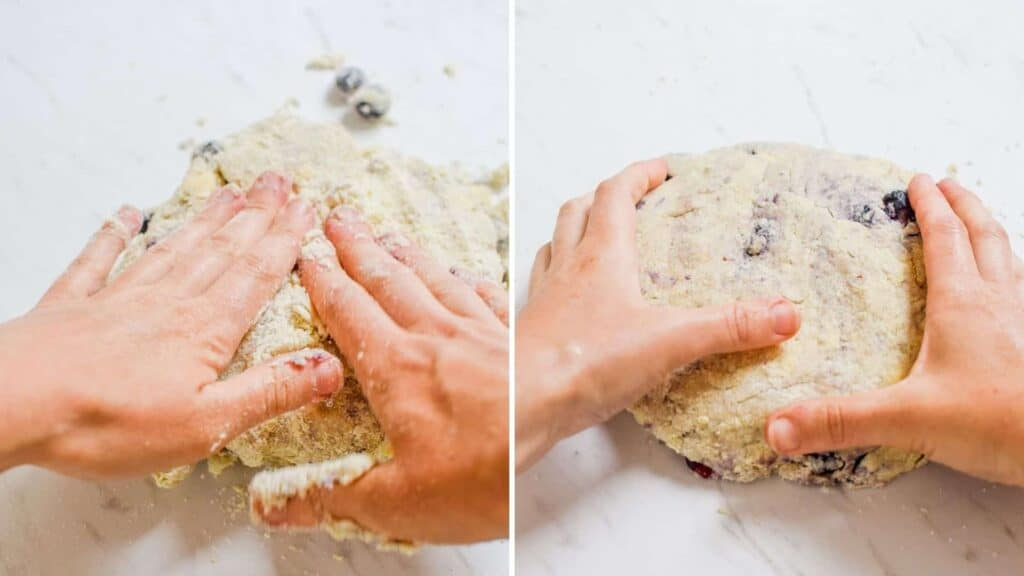 2 side by side pictures of sourdough scone dough with blueberries being molded with two hands on a white bench.