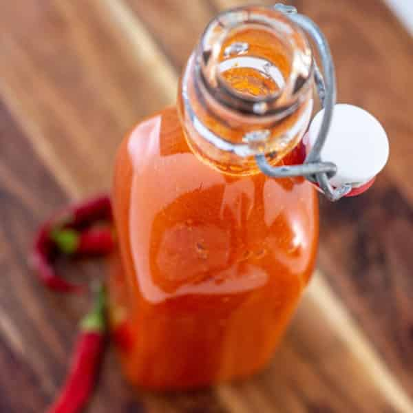 a close up angled birds eye view of the bottle of chili sauce