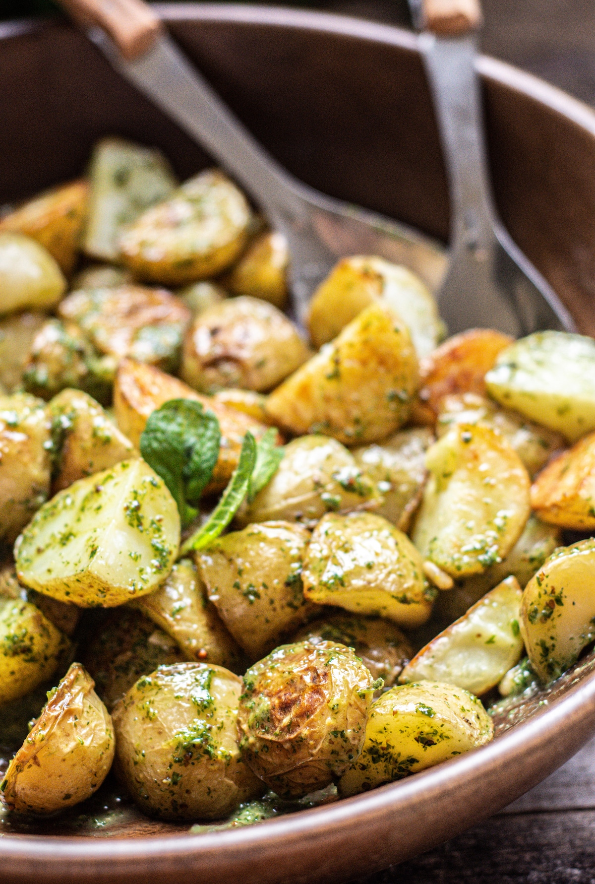 roasted potatoes tossed in green dressing