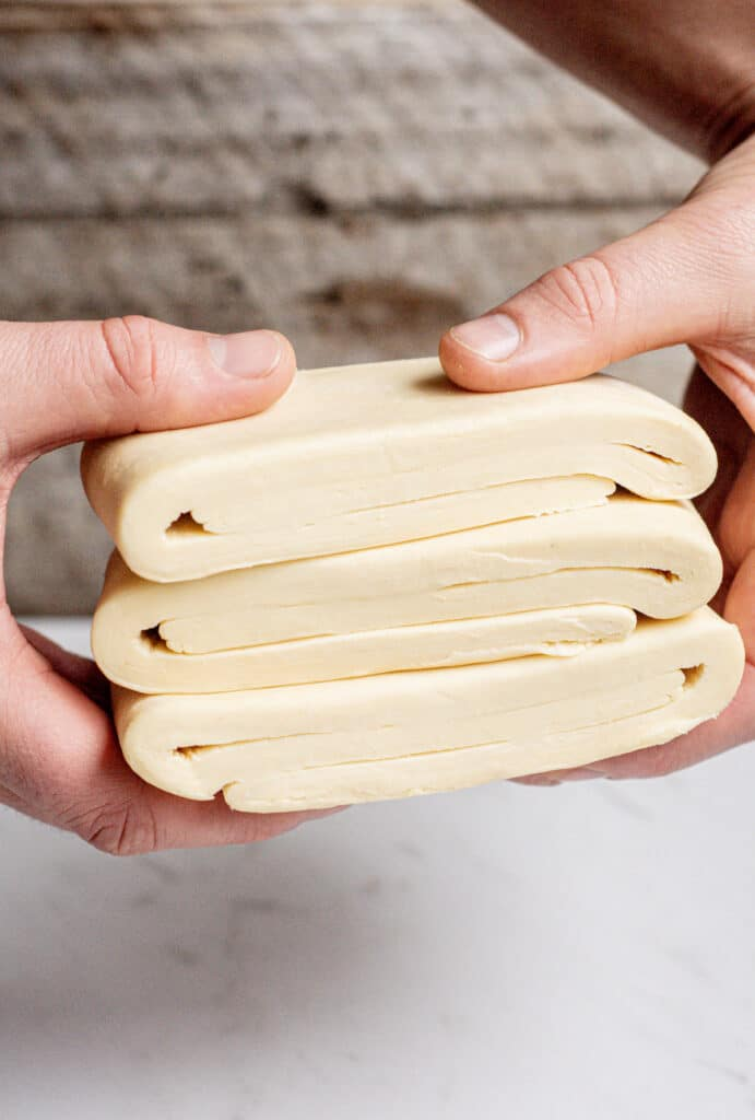 a hand holding sourdough pastry